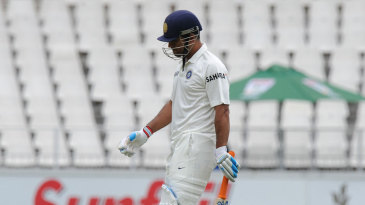 MS Dhoni walks back for 19