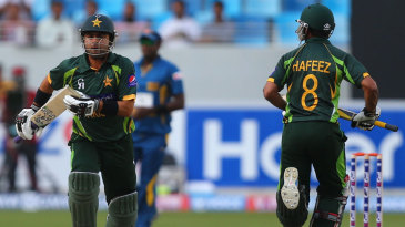 Mohammad Hafeez and Ahmed Shehzad run between the wickets