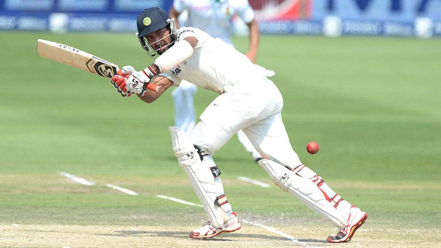 Cheteshwar Pujara flicks to the leg side