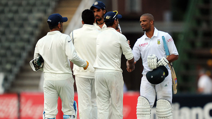 India's players shake hands with Vernon Philander after the Test is drawn