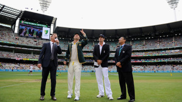 Michael Clarke tosses the coin
