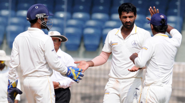 Rahil Shah celebrates a wicket with his team-mates