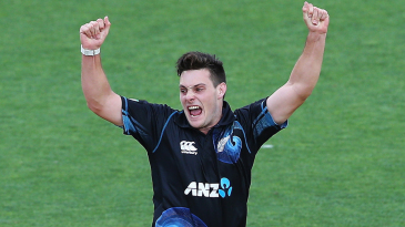 Mitchell McClenaghan is pumped up after a wicket