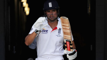 Alastair Cook comes out to begin England's second innings