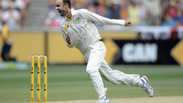 Nathan Lyon wheels away after dismissing Ian Bell