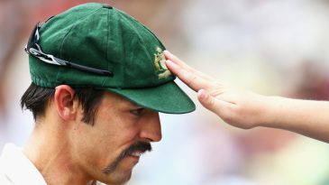 Soak up the power? A fan touches Mitchell Johnson's baggy green