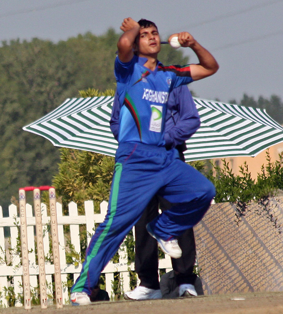 Left-arm spinner Zia-ur-Rehman in his delivery stride