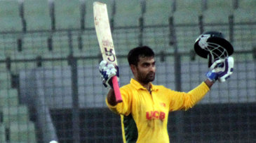 Tamim Iqbal acknowledges the crowd after reaching a maiden T20 ton