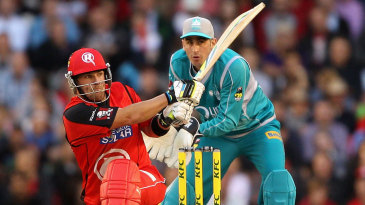 Aaron Finch sweeps during his innings of 81