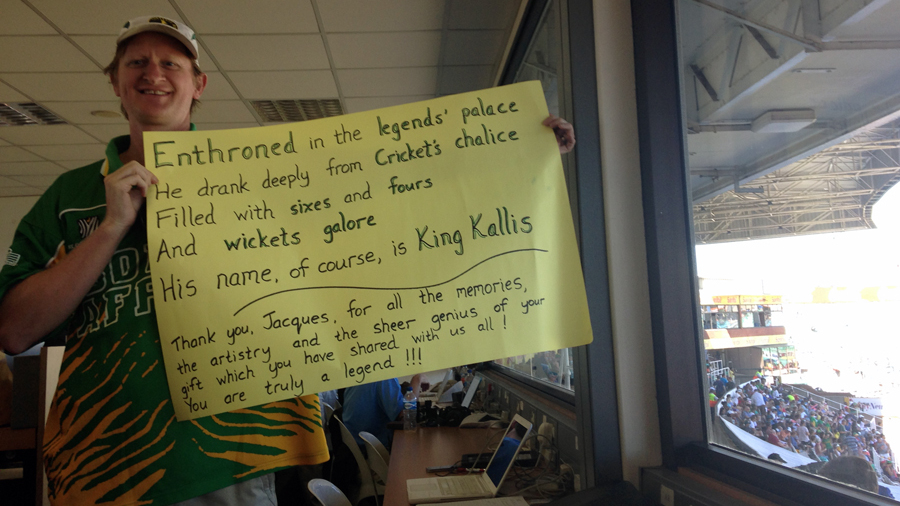 A fan shows off the limerick he has composed for the retiring Jacques Kallis