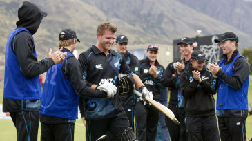 Corey Anderson's team-mates applaud him after his record-breaking effort