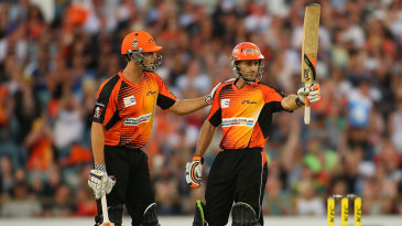 Simon Katich raises the bat after reaching his fifty