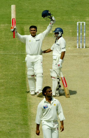 At a strike rate of 82, Virender Sehwag gets to 300 with a massive six, while Sachin Tendulkar ends his innings unbeaten on 194, Pakistan v India, 1st Test, Multan, 2nd day, March 29, 2004