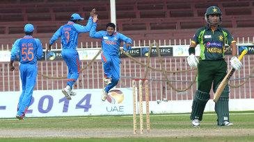 India's U19 players celebrate after dismissing Pakistan U19 captain Sami Aslam for 87