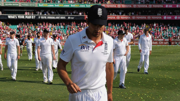 A dejected Alastair Cook leads his team around the outfield