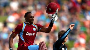 Dwayne Bravo leaps in celebration of his second ODI hundred