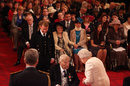 Former cricketer George Chesterton receives his MBE from the Queen, London, October 19, 2012