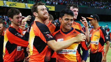 The Perth Scorchers players converge on Yasir Arafat