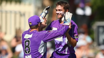 Cameron Boyce exults after taking a wicket