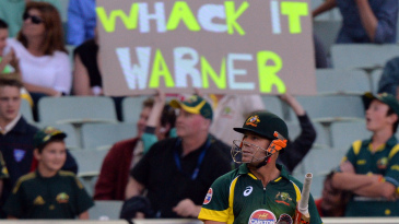 David Warner waits for the decision over his caught behind