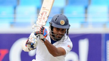 Dimuth Karunaratne drives during his half-century