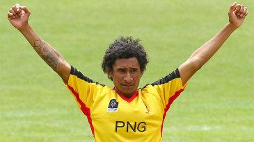 Raymond Haoda celebrates a wicket