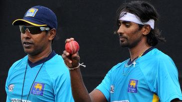 Chaminda Vaas and Nuwan Pradeep at a training session