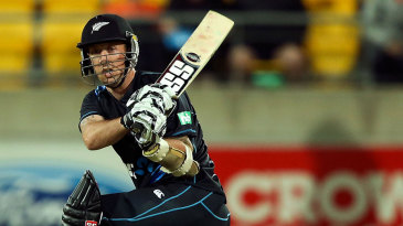 Luke Ronchi clubs the ball over the leg side