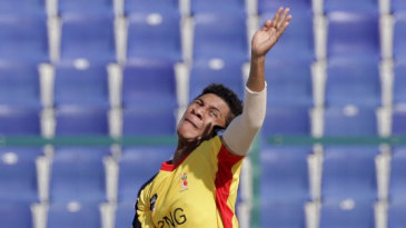 Papua New Guinea legspinner Charles Amini in his delivery stride