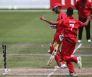 Irfan Ahmed hits the stumps to run out Harvir Baidwan, Canada v Hong Kong, World Cup 2015 qualifiers, Rangiora, January 17, 2014