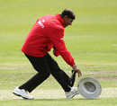 Gone with the wind: Umpire Enamul Haque loses his hat, Canada v Hong Kong, World Cup 2015 qualifiers, Rangiora, January 17, 2014