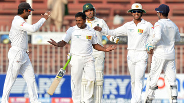 Rangana Herath is congratulated by team-mates after dismissing Ahmed Shehzad