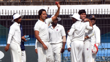 Samad Fallah holds up the ball after taking a wicket