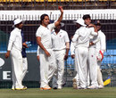 Samad Fallah holds up the ball after taking a wicket, Bengal v Maharashtra, Ranji Trophy, semi-final, Indore, 1st day, January 18, 2014