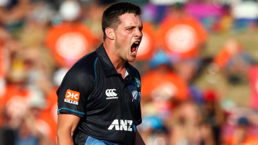 Mitchell McClenaghan celebrates a wicket