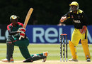Alex Obanda sweeps during his innings of 80, Kenya v Uganda, ICC World Cup 2015 Qualifier, Group B, Mount Maunganui, January 19, 2014