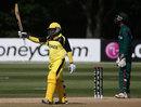 Lepono Ndhlovu raises his bat after reaching 50, Kenya v Uganda, ICC World Cup 2015 Qualifier, Group B, Mount Maunganui, January 19, 2014