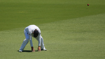 Ian Bell is dejected as a ball races past him on the field