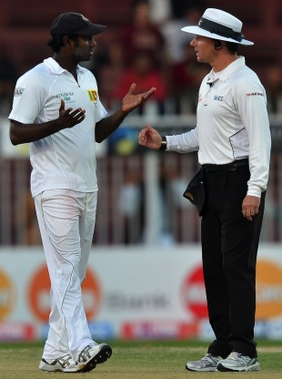 Angelo Mathews speaks to umpire Richard Kettleborough about the light in the final moments of the Sharjah Test