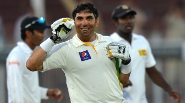 Misbah-ul-Haq gestures to the dressing room after the win