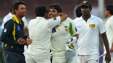 Misbah-ul-Haq is congratulated by team-mates after hitting the winning runs