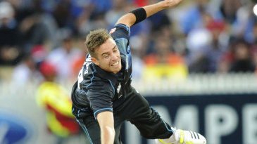 Tim Southee tries to field off his own bowling