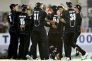 Hamish Bennett is mobbed by team-mates, New Zealand v India, 3rd ODI, Auckland, January 25, 2014