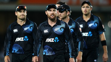 Brendon McCullum leads his team off after the tie
