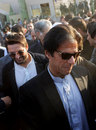 Imran Khan and Shahid Afridi arrive at the launch of a cricket talent hunt, Peshawar, January 25, 2014