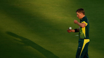 Xavier Doherty prepares to bowl as the shadows lengthen