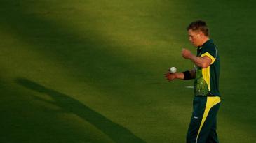 Xavier Doherty prepares to bowl as the shadows lengthen