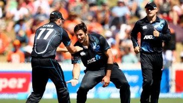 Hamish Bennett celebrates a wicket