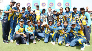 The victorious Sri Lanka team pose with the trophy