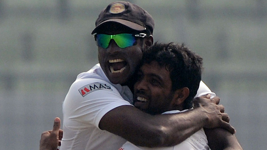 Angelo Mathews embraces Dilruwan Perera after the spinner took a wicket
